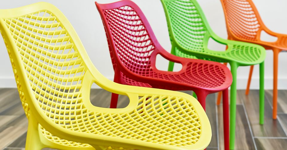 four coloured chairs in a line