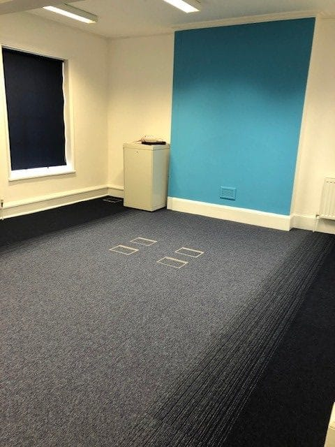 office with blue wall