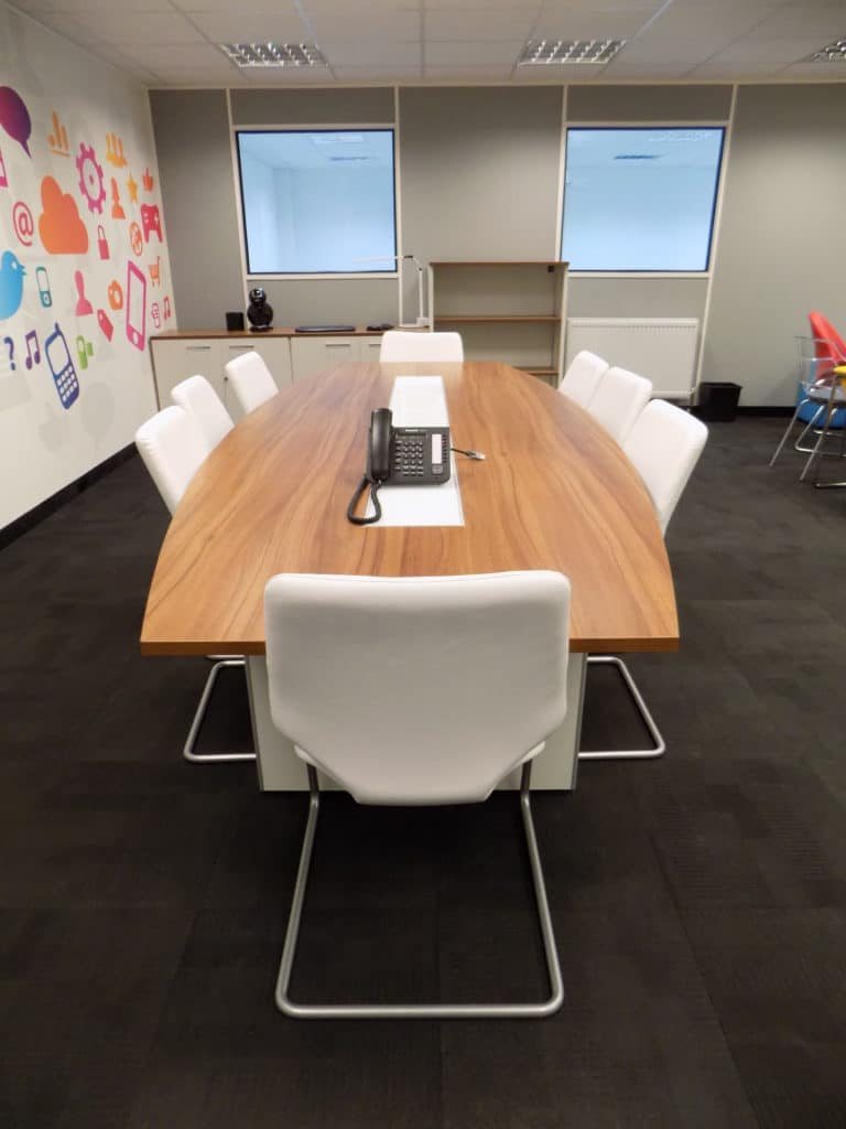 meeting room with white chairs