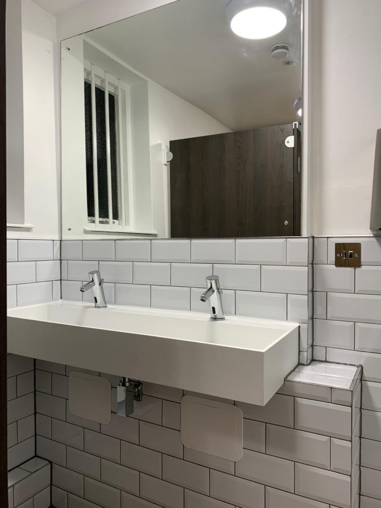 office bathroom sink and mirror
